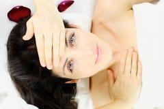 Happy beautiful woman laying in spa Stock Image