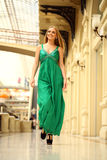 Happy beautiful woman in a long green dress Stock Photography