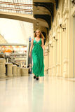 Happy beautiful woman in a long green dress Stock Images