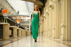 Happy beautiful woman in a long green dress Royalty Free Stock Image