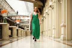 Happy beautiful woman in a long green dress Royalty Free Stock Photography