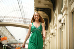 Happy beautiful woman in a long green dress Stock Photos