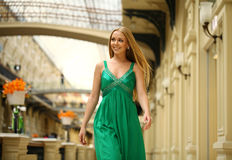 Happy beautiful woman in a long green dress Royalty Free Stock Images