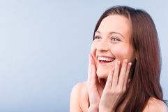 Happy beautiful woman is looking sideways Stock Photos