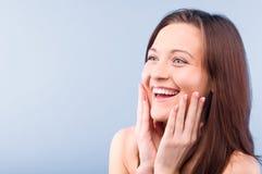 Happy beautiful woman is looking sideways Stock Photos