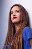 Happy beautiful woman, looking up. Studio shot Stock Photography
