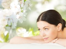 Happy beautiful woman lying in spa Royalty Free Stock Images