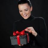 Happy beautiful woman opening a gift box Stock Photo