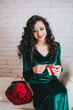 Happy beautiful woman opening present for Valentine's Day Royalty Free Stock Photos