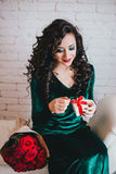 Happy beautiful woman opening present for Valentine's Day Stock Images
