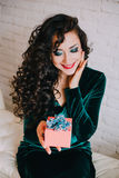 Happy beautiful woman opening present for Valentine's Day Royalty Free Stock Photo