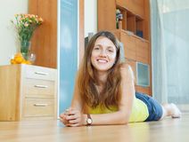 Happy beautiful woman on parquet floor Royalty Free Stock Photo