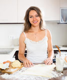 Happy beautiful woman preparing cakes of dough Royalty Free Stock Photos