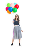 Happy beautiful woman presenting colorful balloons isolated on w royalty free stock photography