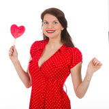 Happy beautiful woman in red dress with colorful lollipop royalty free stock images