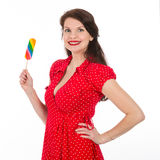 Happy beautiful woman in red dress with colorful lollipop stock photos