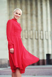 Happy beautiful woman in red summer dress Royalty Free Stock Photography