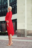 Happy beautiful woman in red summer dress Royalty Free Stock Image