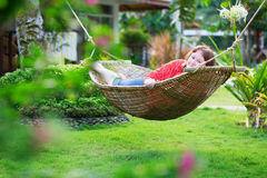 Happy beautiful woman relaxing in hammock Royalty Free Stock Photos