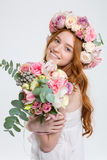 Happy beautiful woman in roses wreath with bouquet of flowers stock photos