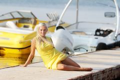 Happy beautiful woman on sea and boat background Royalty Free Stock Photo