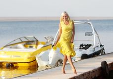 Happy beautiful woman on sea and boat background Stock Image