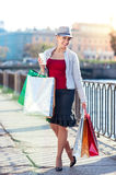 Happy beautiful woman with shopping bags and cup of coffee Royalty Free Stock Photography