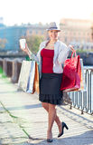 Happy beautiful woman with shopping bags and cup of coffee Royalty Free Stock Images