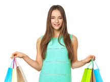 Happy beautiful woman with shopping bags  on white. Royalty Free Stock Image