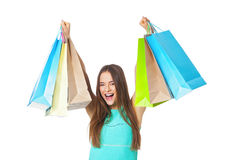 Happy beautiful woman with shopping bags on white. stock photography