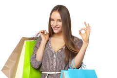 Happy beautiful woman with shopping bags on white. royalty free stock photography