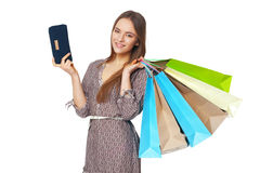 Happy beautiful woman with shopping bags on white. stock photos