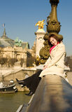 Happy beautiful woman sitting on bridge balustrade Stock Images