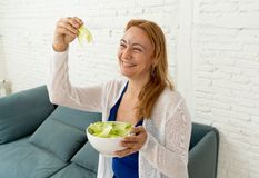 Happy beautiful woman smiling holding healthy fresh vegetable salad in healthy lifestyle concept stock photo