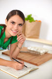 Happy beautiful woman standing in her kitchen Stock Photography
