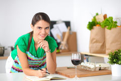 Happy beautiful woman standing in her kitchen Royalty Free Stock Image