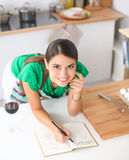 Happy beautiful woman standing in her kitchen Royalty Free Stock Photo