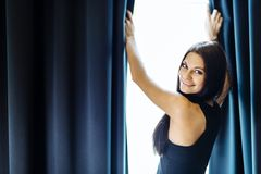 Happy beautiful woman staring out the window. Happy beautiful young woman staring out the window Stock Photo
