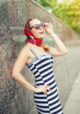 Happy beautiful woman with sunglasses and shawl Royalty Free Stock Photo