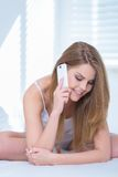 Happy beautiful woman talking on a mobile phone Royalty Free Stock Image