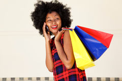 Happy beautiful woman talking on phone with bags Royalty Free Stock Photography
