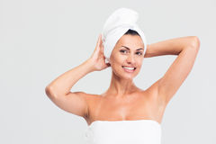 Happy beautiful woman with towel on head royalty free stock image