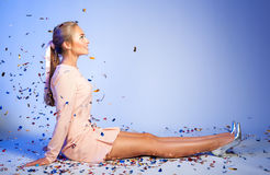 Happy beautiful woman under confetti. people, holidays, emotion. And glamour concept Royalty Free Stock Photos
