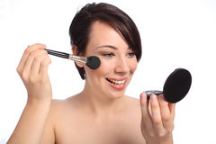 Happy beautiful woman using make up blusher brush Royalty Free Stock Photography