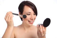 Happy beautiful woman using make up blusher brush Royalty Free Stock Photography
