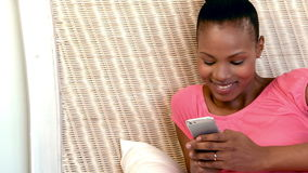 Happy beautiful woman using mobile phone. At home stock footage