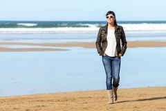 Woman walking on beach Royalty Free Stock Photography
