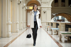 Happy beautiful woman walking in the shop Royalty Free Stock Photos