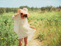 Happy beautiful woman walking in summer park Stock Images