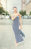 Happy beautiful woman wearing striped dress Royalty Free Stock Images